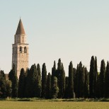Basilica, belltower and cypress trees