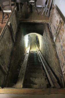 Steps down to the hidden wine cellar