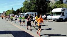Marathon runners stream by Bertha